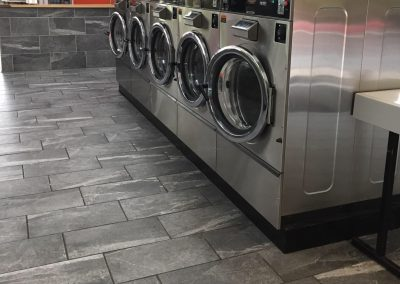 Interior shot of washing machines at the Clifton location