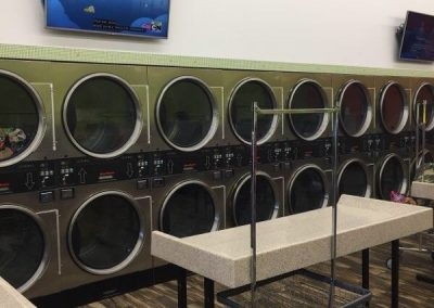 Interior shot of washing machines at the Covington location