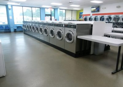 Interior shot of washing machines at the Western Hills location.